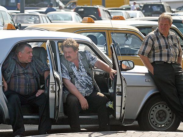 Город и область начали войну за таксистов
